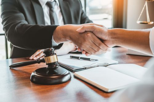 lawyer shaking clients hand