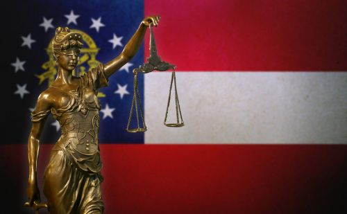 lady justice in front of georgia state flag